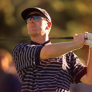 "Aug. 8, 1999 - David Duval follows his tee shot on the third hole of his 18-hole match against Tiger Woods at Sherwood CC in Thousand Oaks , Calif., Monday, Aug. 2, 1999. The $1.5 million ""Showdown at Sherwood,"" a one-round, match-play duel between the world's two highest-ranked golfers, is the first golf event televised live in prime time by a network."