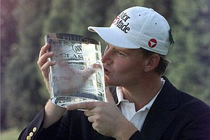 June 22, 1997 - Ernie Els of Fancourt, South Africa, kisses the trophy after winning the Buick Classic at Westchester CC in Harrison, N.Y. Sunday, June 22, 1997. Els, who finished at 16-under-par 268, tied the tournament record.
