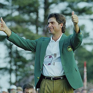 April 5/March 22, 1992 - Fred Couples gives the thumbs up after getting his green jacket Sunday, April 12, 1992 after winning the 1992 Masters at the Augusta National Golf Club in Augusta, Ga. Couples won his first at a major with a score of 13-under-par.