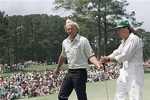 Nov. 6, 1988 - Greg Norman hands his club to his caddy on number two green after he made birdie during final round of the Masters at the Augusta National Golf Club, April 10, 1988.