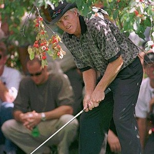 Sept. 7, 1997 - Greg Norman lines up his shot from under a tree during second round Bell Canadian Open Friday, Sept. 5, 1997 in Montreal. Norman finished at two-under par.