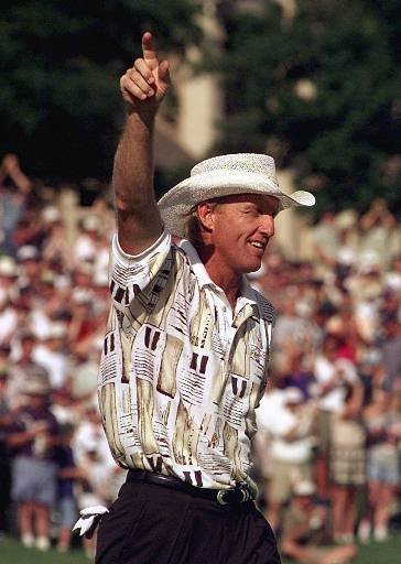 June 29, 1997 - Greg Norman celebrates his birdie putt on the 18th hole to win the St. Jude Classic in Memphis, Tenn., on Sunday, June 29, 1997. Norman finished with a 16-under-par 268, one stroke ahead of Dudley Hart.