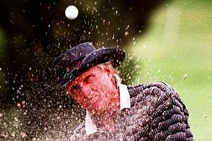 April 27, 1997 - Greg Norman blasts the ball out of the bunker during the final round of the Spanish Open in Madrid's La Moraleja course Sunday April 27, 1997. Norman finished second behind England's Mark James.