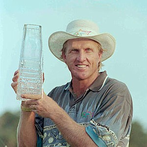 Feb. 6, 1994 - Greg Norman of Australia holds up his trophy after winning the Players Championship in Ponte Vedra Beach, Fla. Sunday, March 27, 1994. He won with a record breaking 24-under-par.