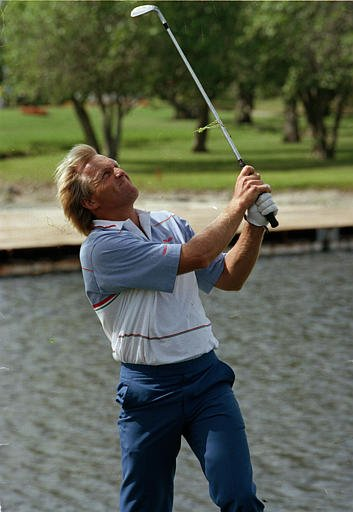 Oct. 14, 1990 - Greg Norman chips from the rough on the 8th green during the first round of the Doral-Ryder Open in Miami, Fla., Thursday, March 1, 1990.