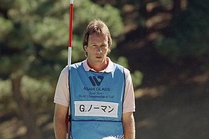Aug. 20, 1989 - Australia's Greg Norman contemplates his putt during opening round of Four Tours World Championship of Golf at the Yomiuri Country Club Course, west of Tokyo, Nov. 2, 1989 in Inagi, Japan. Norman, as the captain of the Australia-New Zealand team in the team competition among four PGA Tours from the U.S., Europe, Australia-New Zealand and Japan, scored 68, helping his team beat Japan. His caddie Bruce Edwards looks on.
