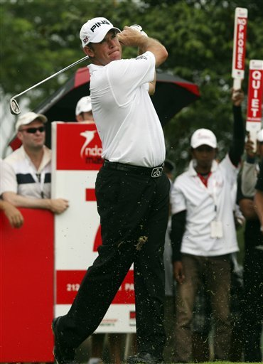 April 24, 2011 – Lee Westwood of England watches his tee shot at the 7th hole during the final round of Indonesian Masters at Royale Jakarta GC in Jakarta, Indonesia, Sunday, April 24, 2011. Westwood took over as No. 1 on the World Golf Rankings.