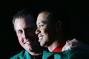 April 10, 2005 - Tiger Woods, right, get the Green Jacket from Phil Mickelson, left, last years Masters champion, after Woods won the 2005 Masters in a playoff at the Augusta National Golf Club in Augusta, Ga., Sunday, April 10, 2005.