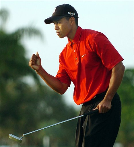 March 6, 2005 - Tiger Woods pumps is fist on the 17th green during the final round at Ford Championship at Doral Sunday, March 6, 2005.