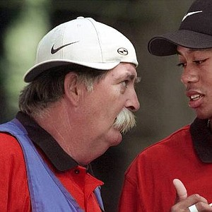 """June 14, 1998 - Tiger Woods talks with his caddie, Mike """"Fluff"""" Cowan, before teeing off on No. 2 during the final round of the PGA Championship at the Sahalee CCin Redmond, Wash., on Sunday, Aug. 16, 1998."""