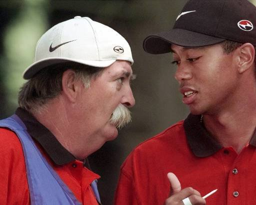 "June 14, 1998 - Tiger Woods talks with his caddie, Mike ""Fluff"" Cowan, before teeing off on No. 2 during the final round of the PGA Championship at the Sahalee CCin Redmond, Wash., on Sunday, Aug. 16, 1998."
