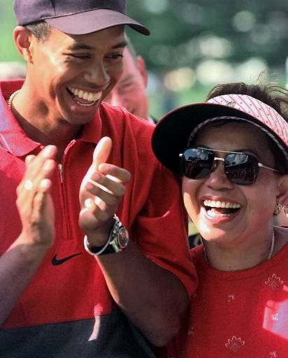 July 6, 1997 - Twenty-one-year-old Tiger Woods enjoys a laugh with his mother, Kultida, after winning the Western Open at Cog Hill Golf & CC in Lemont, Ill., Sunday, July 6, 1997. Woods is the second-youngest person in the history of pro golf to reach six victories. Horton Smith, who played in the 1920s, had seven before he turned 21.