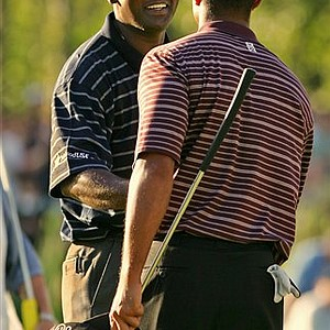 Sept. 6, 2004 - Vijay Singh smiles at Tiger Woods as they shake hands on the 18th green after Singh won the Deutsche Bank Championship at TPC Boston in Norton, Mass. Monday, Sept. 6, 2004 by three strokes over Tiger Woods and Adam Scott. Singh won a head-to-head matchup with Woods to end his record reign atop golf's ultimate leaderboard. Singh shot a 69 clinching the No. 1 ranking in the world with his sixth victory of the year. Woods had been first for more than five years - a record 264 consecutive weeks.