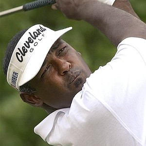 May 22, 2005 - Vijay Singh of Fiji follows through on a tee drive on the Tournament Players Course during the first round of the Byron Nelson Championship in Irving, Texas, Thursday, May 12, 2005.