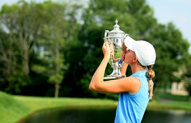 Amy Anderson, the 61st U. S. Girls' Junior Champion at Trump National Golf Club in Bedminster, New Jersey, kisses the Glenna Collett Vare Trophy.