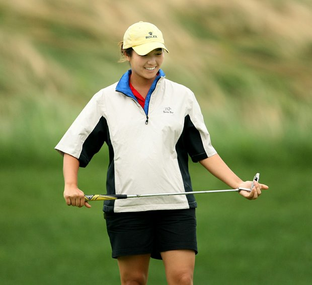 Kimberly Kim reacts to a putt during Thursday match play of the 61st U. S. Girls' Junior Championship at Trump National Golf Club in Bedminster, New Jersey.
