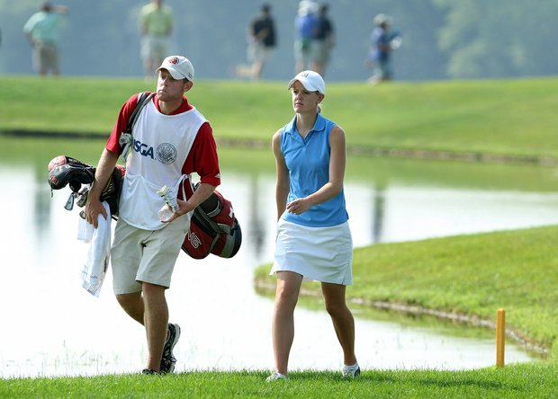 Amy Anderson and her brother/caddie Nathan walk up the fairway at no. 10 during the first round of Saturday's final of the 61st U. S. Girls' Junior Championship at Trump National Golf Club in Bedminster, New Jersey.