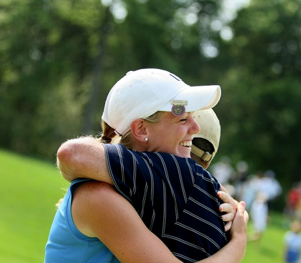 Amy Anderson hugs her father Mark Anderson after winning the 61st U. S. Girls' Junior Championship at Trump National Golf Club in Bedminster, New Jersey.