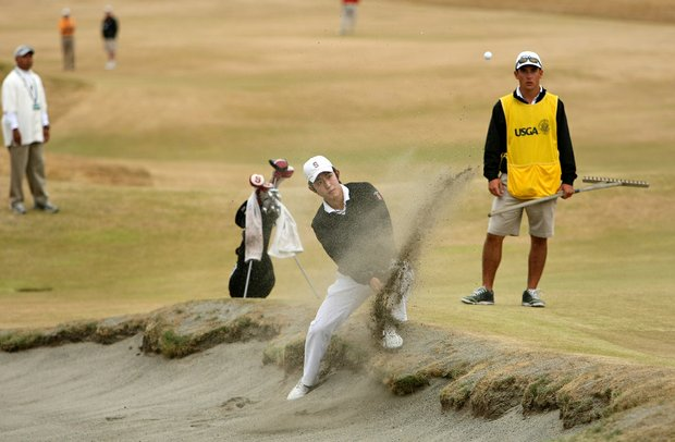 David Chung takes an odd stance to hit out of the bunker at No. 6 during quarterfinals of the 110th U.S. Amateur Championship at Chambers Bay in University Place, Wash.