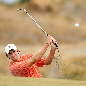 Peter Uihlein hits his bunker shot at No. 17 during the first 18 holes of the finals of the 110th U.S. Amateur Championship at Chambers Bay in University Place, Wash.