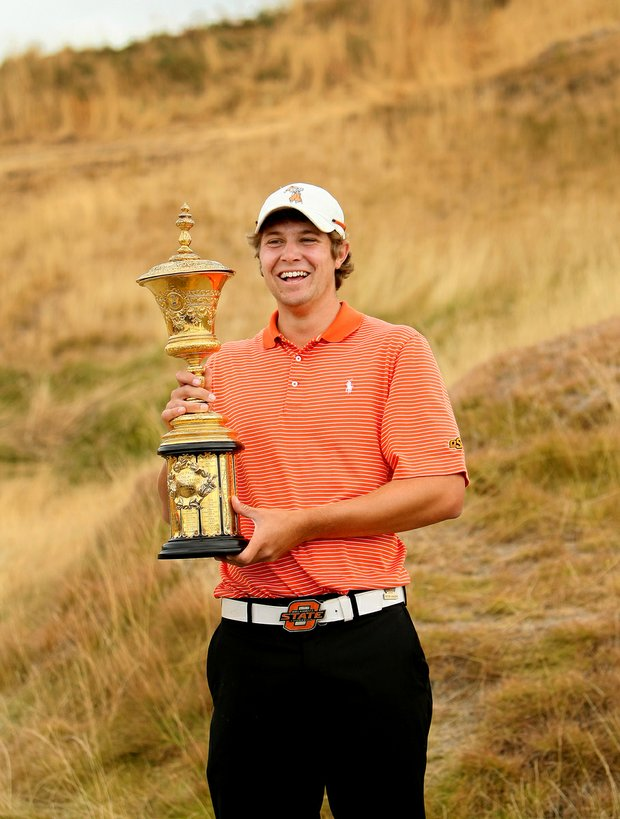 Peter Uihlein holds The Havemeyer Trophy after winning the 110th U.S. Amateur Championship at Chambers Bay in University Place, Wash.