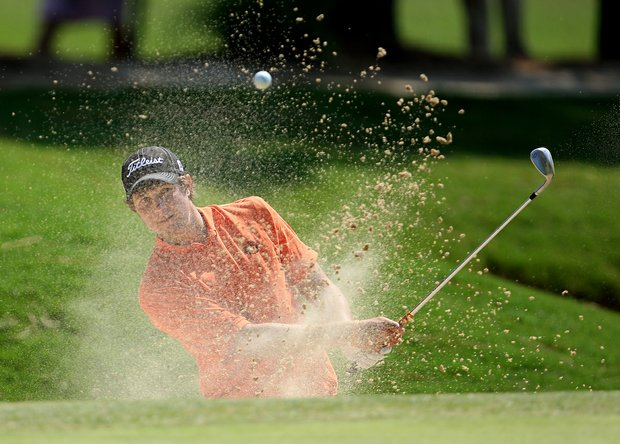Peter Uihlein hits out of a bunker at the 16th hole on Course No. 2 during Tuesday's 2008 U. S. Men's Amateur.