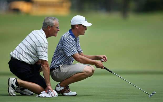 Robbie Fillmore, right, gets help reading a putt from his caddie/dad Robert Fillmore during Tuesday's 2008 U. S. Men's Amateur.