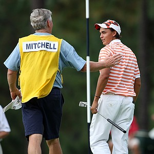 Adam Mitchell's caddie talks to Rickie Fowler after Mitchell defeated Fowler in round three of the 2008 U.S. Amateur.