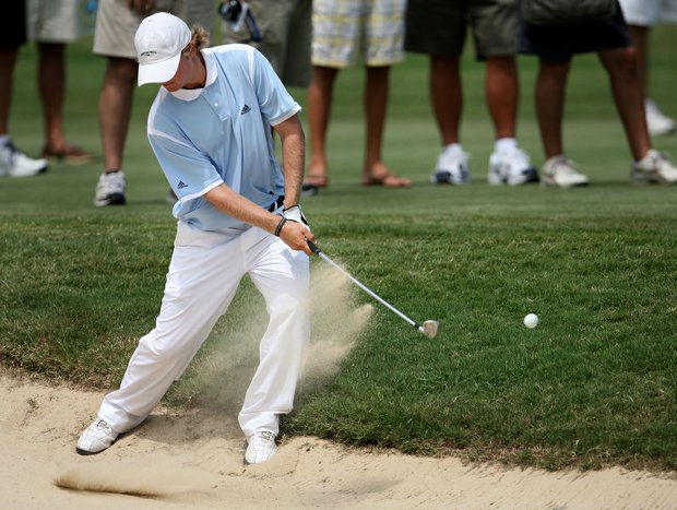Charlie Holland hits his bunker shot over the green at the 14th hole during quarterfinal match play at the 2008 U. S. Amateur.
