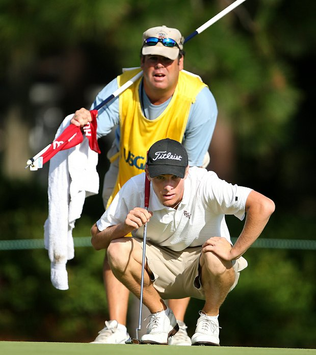 Drew Kittleson and his caddy on the first green during Saturday's semifinal match play at the 2008 U. S. Amateur.