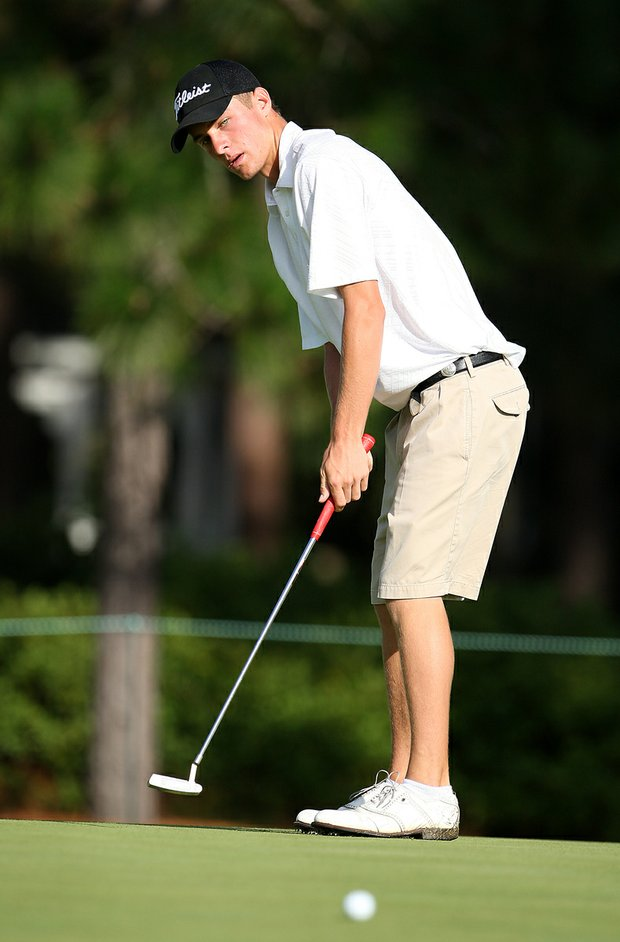 Drew Kittleson watches his putt on the first green during Saturday's semifinal match play at the 2008 U. S. Amateur.