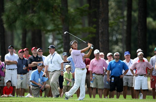 Danny Lee hits his third shot at the 30th hole after barely advancing his second shot during the 2008 U. S. Amateur.