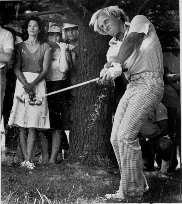 Australia's Greg Norman, third round leader, blasts out of the trees on the fourth hole during the Kemper Open at Congressional Country Club in Bethesda, Md., Saturday, June 2, 1984.