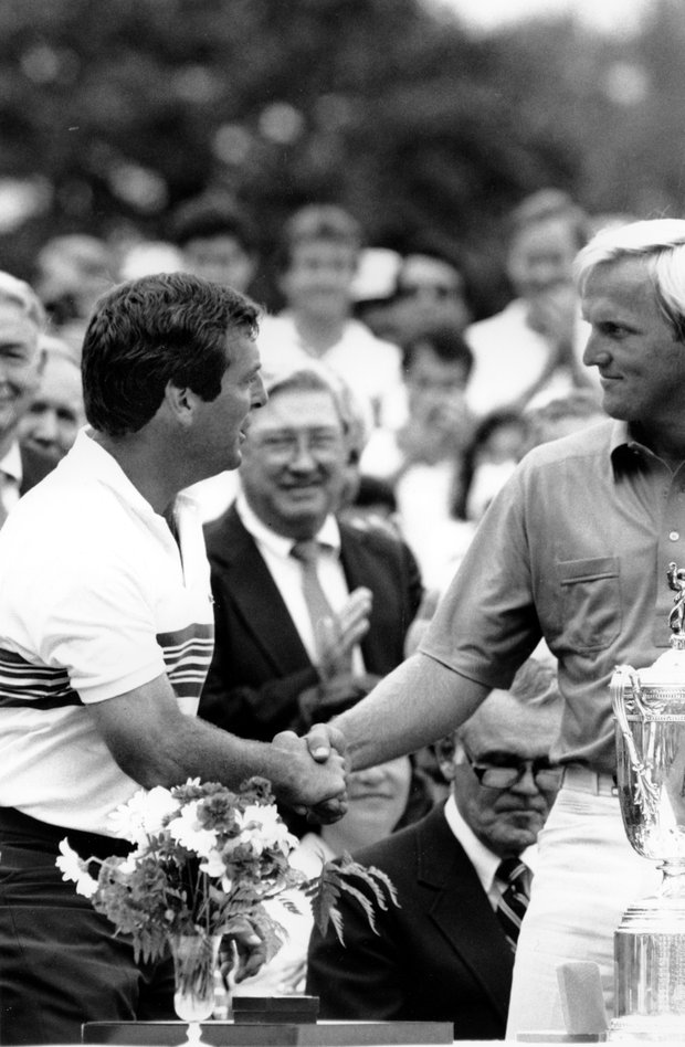 Fuzzy Zoeller, left, shakes hands with Greg Norman during presentation ceremonies at the Winged Foot Golf Club in Mamaroneck, N.Y. on Monday, June 18, 1984. Zoeller defeated Norman in an 18-hole playoff to win the U.S. Open Championship. The two tied at the end of the regulation 72 holes forcing the playoff.