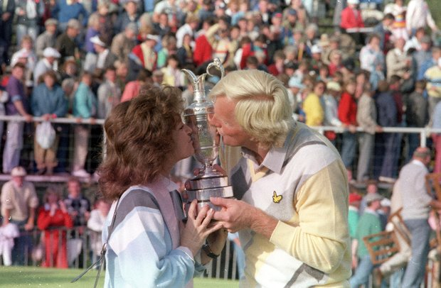 "British Open champion Greg Norman and his wife, Laura, kiss his trophy at Turnberry, Scotland, Sunday, July 20, 1986. Norman, known as the ""White Shark,"" won the tournament with a score of 280."