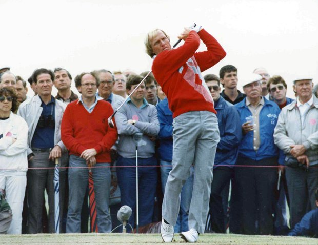 Watched by an attentive audience, defending Open Champion Australian Greg Norman, tees off during a practice round , before the start of the Open Golf Championships, at Muirfield, Scotland, on July 15, 1987.