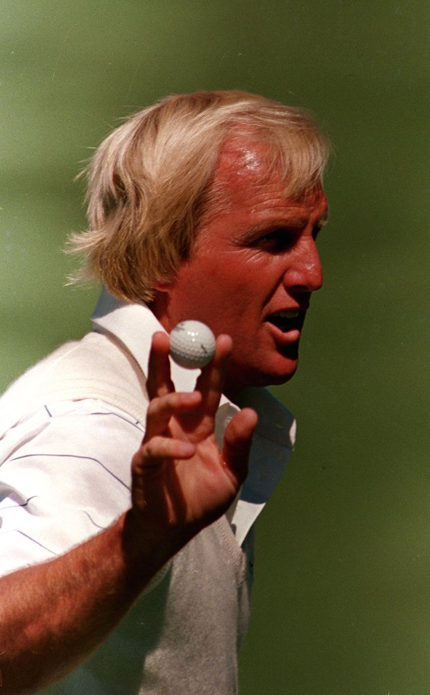 Greg Norman of Australia gestures to the crowd with the ball after he made a birdie shot on number two during second round of the Masters golf tournament at the Augusta National Golf Club in Augusta, Ga., April 8, 1988.