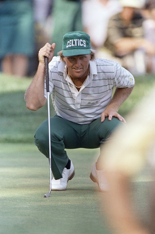 Australian Greg Norman wears a Boston Celtics cap as he lines up a putt on the 18th green during practice round at the U.S. Open in Brookline, Mass.,, Tuesday, June 15, 1988. First round play start on Thursday.