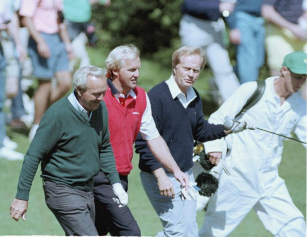From left to right, four-time Masters winner Arnold Palmer, Greg Norman, from Australia, and six-time Masters winner Jack Nicklaus walk to the fifth green during Masters practice at the Augusta National Golf Club in Augusta, Ga., Tuesday, April 3, 1990.