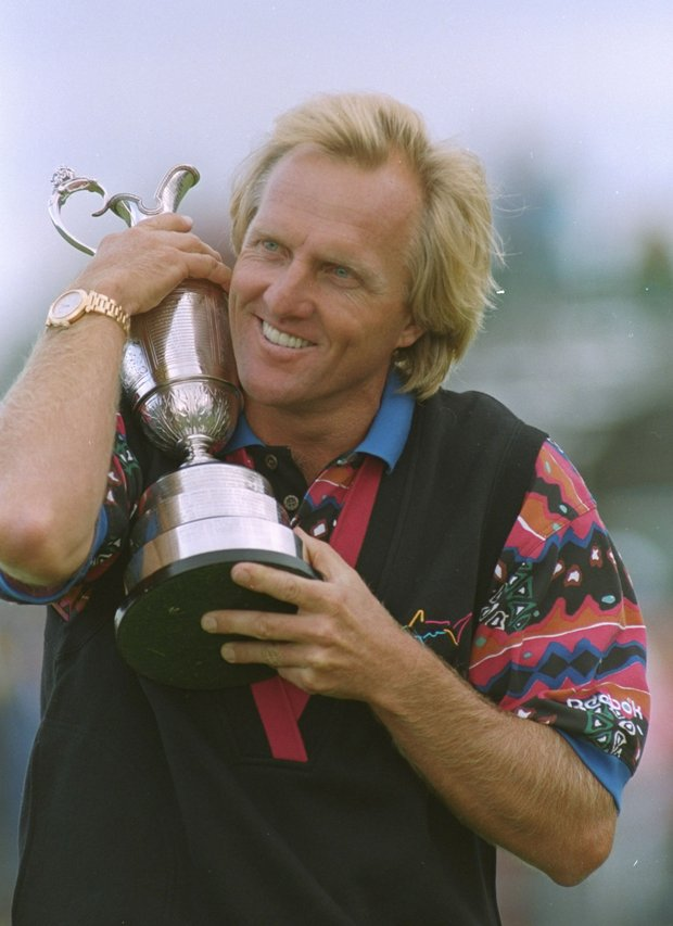 "Australia's Greg Norman hugs the trophy after winning the British Open Golf Championship, Sunday, July 18, 1993 at Royal St. Georges golf club, Sandwich, England. Norman came back -- all the way back, beating old nemesis Nick Faldo with a record score and acquiring his second British Open golf championship. ""Perfect,"" Norman said after a 6-under-par 64 that represented one of the great rounds of his globe-trotting career."