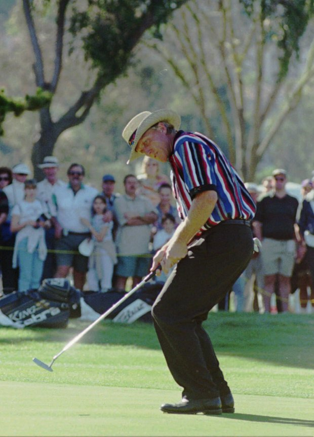 Greg Norman uses a bit of body english to coax his seventh straight birdie into the cup on the eighth hole during the final round of the Mercedes Championships Sunday Jan. 7, 1995 in Carlsbad, Calif. Norman, who made the putt, started the day at three-over-par but shot 29 on the front nine.