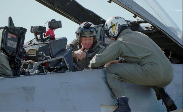 Golfer Greg Norman gives the thumbs up to Navy Lt. Brian Kulas as he receives instructions from Kulas while sitting in the back seat of a Navy F-14 Tomcat fighter Thursday Dec. 14, 1995 at Navy's Top Gun School at the Miramar Naval Airstation in San Diego. Norman fulfilled a life long dream to fly in a Navy fighter and land on an aircraft carrier.