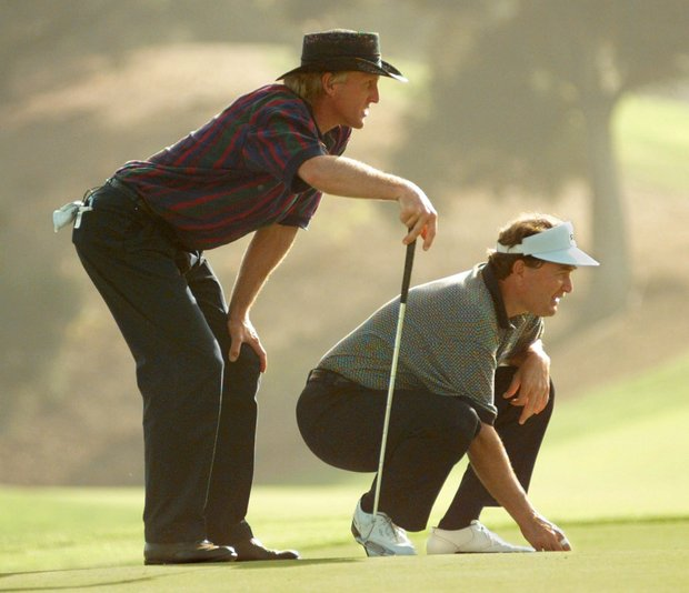 Greg Norman, left, and his partner Raymond Floyd line up a putt together on the 18th hole during the Franklin Templeton Shark Shootout in Thousand Oaks, Calif., Friday, Nov. 17, 1995. Norman and Floyd finished at 7-under for the day.