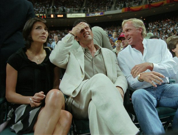 Sylvester Stallone, center, along with wife Jennifer Flavin and Greg Norman cheer during the Miami Heat, Chicago Bulls game three of the NBA Eastern Final Championship being played in Miami, Saturday May 24, 1997.