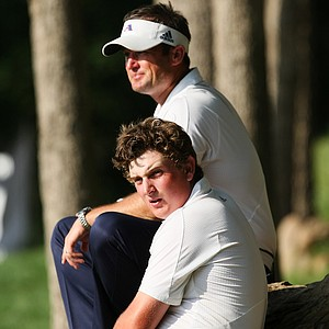 Josh Gregory, top, and Henrik Norlander, bottom, of the defending champions Augusta State watch as the team comes in at No. 18 during Tuesday stroke play at the 2011 NCAA Division I Men's Golf Championship.