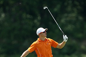 Oklahoma State's Morgan Hoffmann watches his second shot at No. 9 during Tuesday stroke play at the 2011 NCAA Division I Men's Golf Championship.