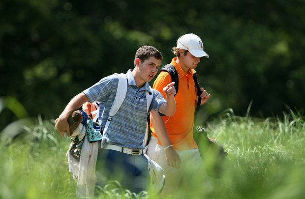 UCLA's Patrick Cantlay and Oklahoma State's Peter Uihlein, leave the 18th tee during Tuesday stroke play at the 2011 NCAA Division I Men's Golf Championship.