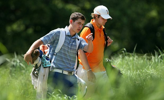 UCLA freshman Patrick Cantlay, left, and Oklahoma State junior Peter Uihlein walk off the 18th tee Tuesday at the NCAA Championship.