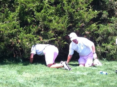Alabama freshman Trey Mullinax and coach Jay Seawell search for his tee shot in the opening round of the NCAA Championship.