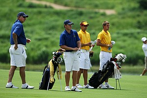 California head coach, Steve Desimone, left, with Michael Weaver and University of Southern California assistant coach Josh Brewer with T. J. Vogel during Wednesday stroke play.